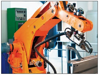 The simplest implementation of lights-out manufacturing is the replacement of a human arm with a robotic arm.